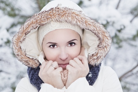 portrait of the beautiful young woman in the winter clothes photo