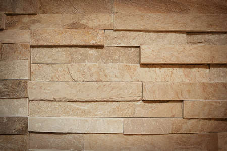 lain: a close up of creamy color sandstone wall Stock Photo