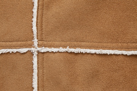 a close up of a suede and fur jacket texture photo