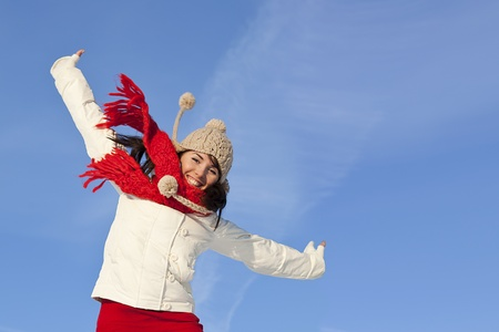 happy girl with a red scarf on the sky background photo