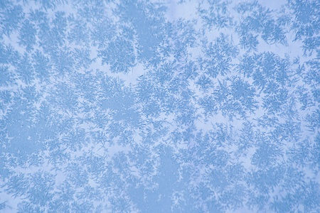 frosted window glass texture in winter time photo