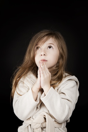 praying angel: little blond girl sending her message to God Stock Photo