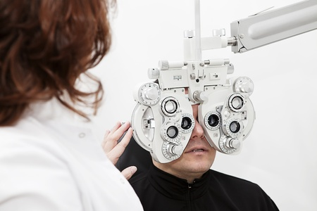man being sight tested by the optometrist photo