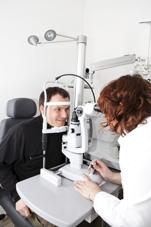 optometrist doing sight testing examination for her patient