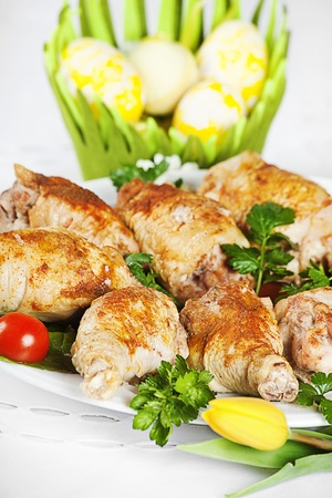 plate of roasted turkey with easter egg and flower decoration photo