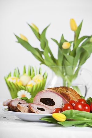 roulade: tradditional pork loin dish with easter decorations Stock Photo