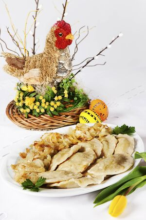 pierogi: tradditional easter dumplings with  easter hen decoration Stock Photo