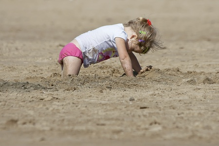 little cute girl looking for the treasure