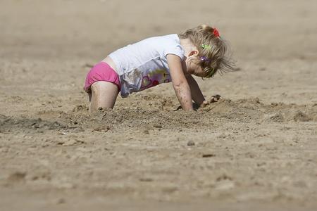 treasure hunt: little cute girl looking for the treasure