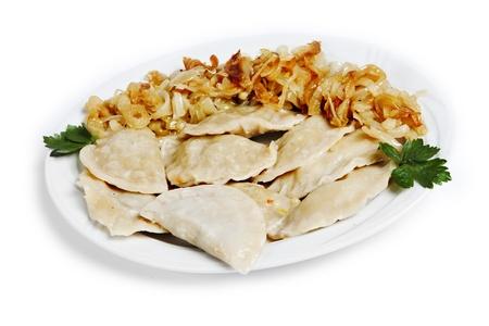 pierogi: plate of stuffed dumplings - traditional polish dish