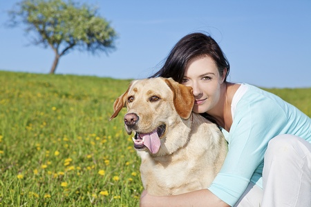 beautiful girl with her yellow labrador friend