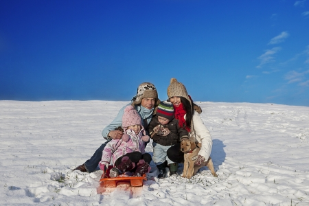 family playing with the snow during the holidays Stock Photo - 16878395