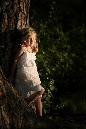 only girls: little girl posing for the photograph on a sunny evening Stock Photo