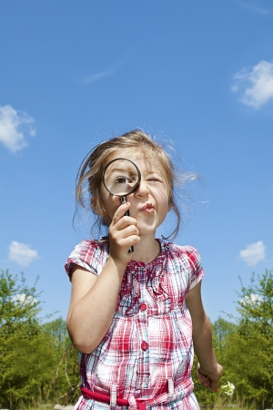 little curious girl with the magnifying glass Stock Photo - 17541584