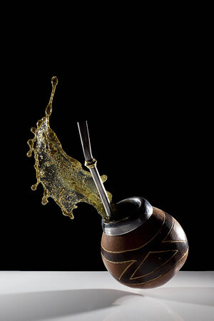 mate drink: splash of Yerba Mate shows an explosion of energy Stock Photo