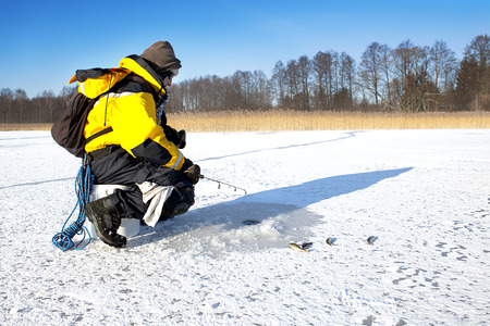 ice fishing: Ice Fishing in winter scene