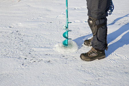 auger: Ice auger -  tool is for drilling  fishing hole in the ice