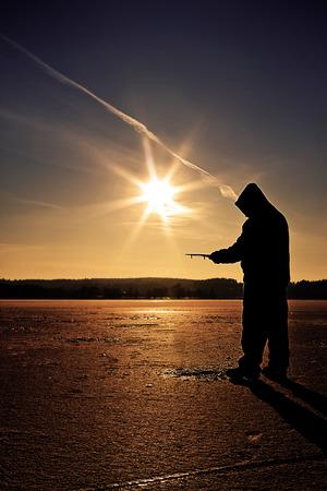 ice fishing: Ice Fishing in winter scene