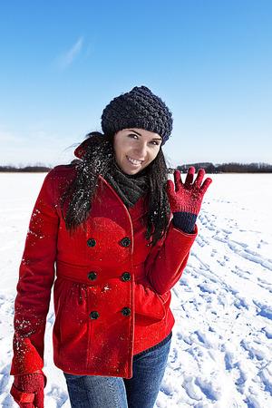 woman having fun in winter scene photo