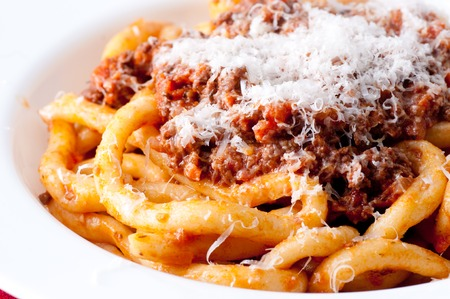 pici pasta with lamb ragu and parmesan cheese Stock Photo