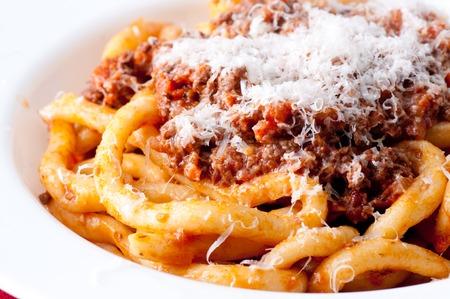 pizzoccheri: pici pasta with lamb ragu and parmesan cheese Stock Photo