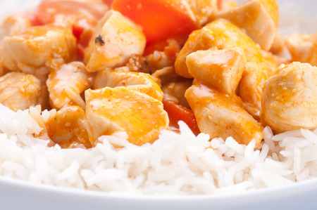 indian butter chicken with carrots  over white rice