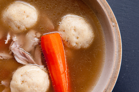 matzo balls: home made matzoh ball soup with carrots and chicken