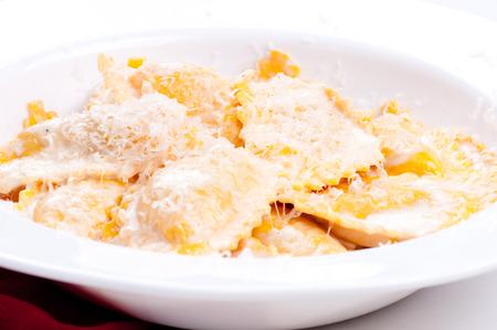 alfredo: butternut squash stuffed pasta with a creamy alfredo sauce Stock Photo
