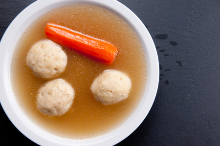 ashkenazi: home made matzoh ball soup with carrots and chicken