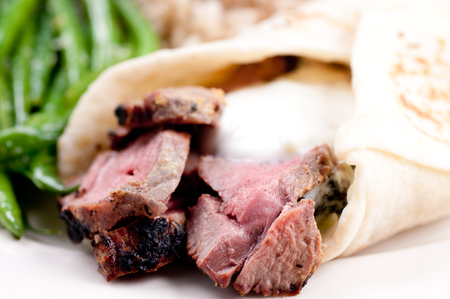 the lamb: lamb wrap in a soft homemade flatbread with coconut rice and garlic fried beans