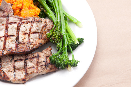 farm raised heritage pork sirloin chops with fresh vegetabes