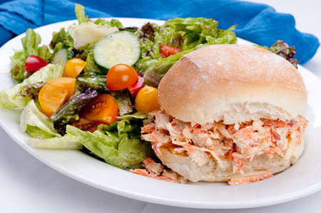side salad: apple chicken salad sandwich with a side salad