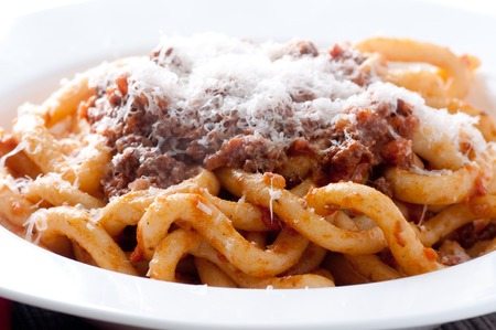 pizzoccheri: pici pasta with lamb ragu and parmesan cheese Stock Photo