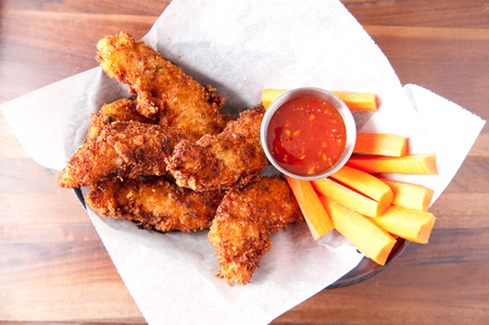 tenders: chicken tenders or strips with a spicy chilli sauce and vegetable sticks