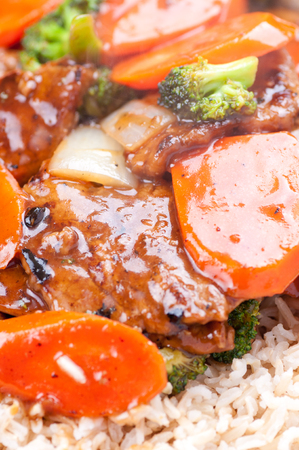 stir fry: beef with broccoli and carrot stir fry over brown rice Stock Photo