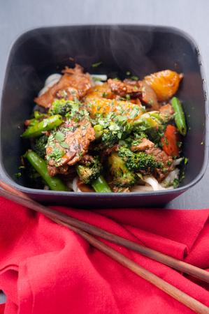 stir fry: oranger beef stir fry with udon noodles Stock Photo