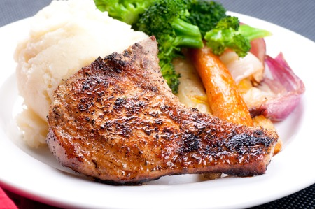 pork rib: grilled pork rib chop with mashed potato and roasted carrot Archivio Fotografico