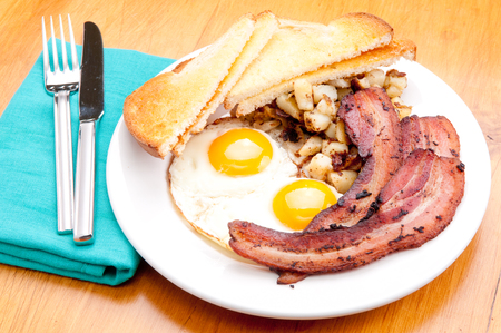 hashbrowns: sunny side up eggs with organic bacon, hashbrowns and crsipy  toast