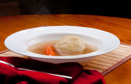 matzo: home made matzoh ball soup with carrots and chicken