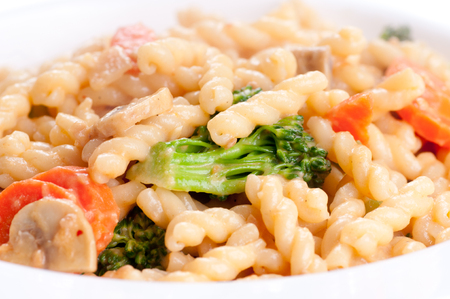 fresh vegetables with gemelli noodles and a tamato cheese sauce Stock Photo
