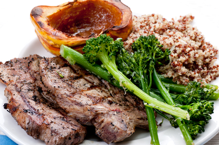 pork neck chops with roasted squash and quinoa Stock Photo