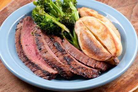 flank: rare flank steak with potato wedges and brocolli