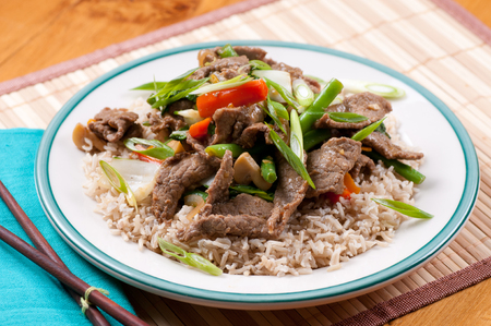 orange and ginger beef stir fry over brown rice Stock Photo