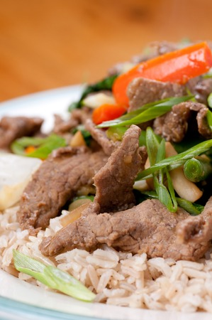 stir fry: orange and ginger beef stir fry over brown rice Stock Photo