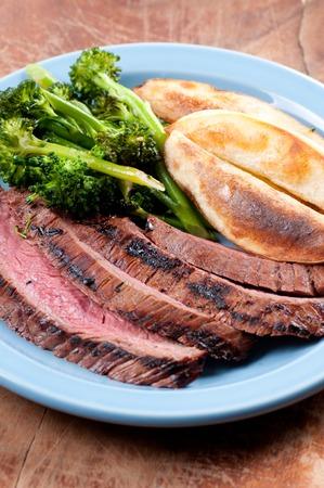 flank: rare flank steak with potato wedges and brocolli