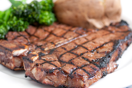 tbone: a delicious t-bone steak grilled to perfection Stock Photo