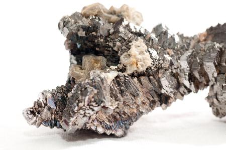 magnetic stones: arsenopyrite metal mineral sample with quartz crystals and granite