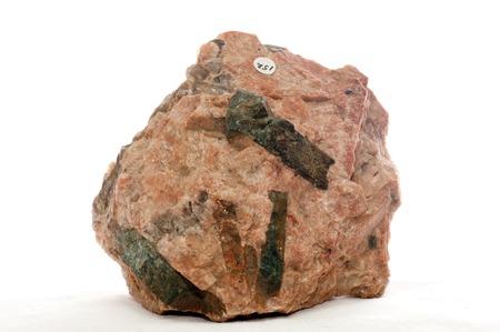 gemology: green beryl crystal mineral sample embedded in granite Stock Photo