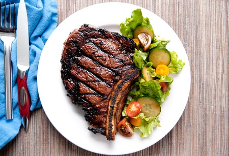 steak grill: a rare rib steak cooked to perfection on the grill Stock Photo