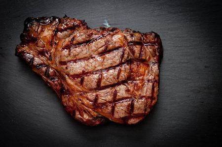 ethically raised, fresh cut organic rib eye steak grilled rare Stock Photo